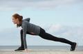 Sportswoman stretching leg muscles
