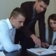 Group Of Businessmen Are Standing Around a Table  - VideoHive Item for Sale