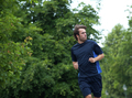 Fit young man jogging outdoors