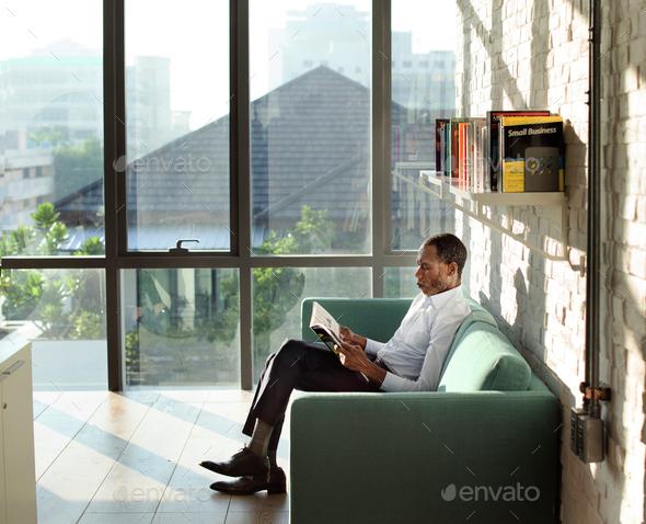 Businessman Reading Magazine Relaxation Concept - Stock Photo - Images