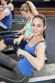 Fit people on drawing machine at gym
