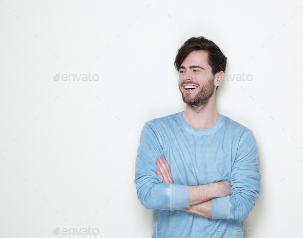 Attractive man smiling with arms crossed - Stock Photo - Images
