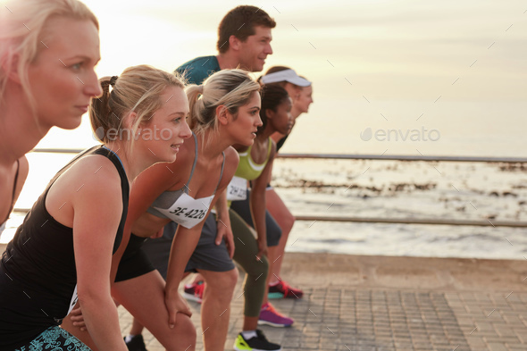Runners on standing at start line of a race - Stock Photo - Images