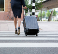 Businesswoman crossing street with luggage - PhotoDune Item for Sale