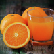 Orange juice glass and fresh oranges on wood - PhotoDune Item for Sale