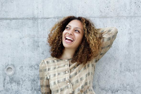 Portrait of a joyful young woman - Stock Photo - Images