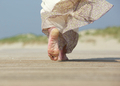 Female feet walking away at the beach - PhotoDune Item for Sale
