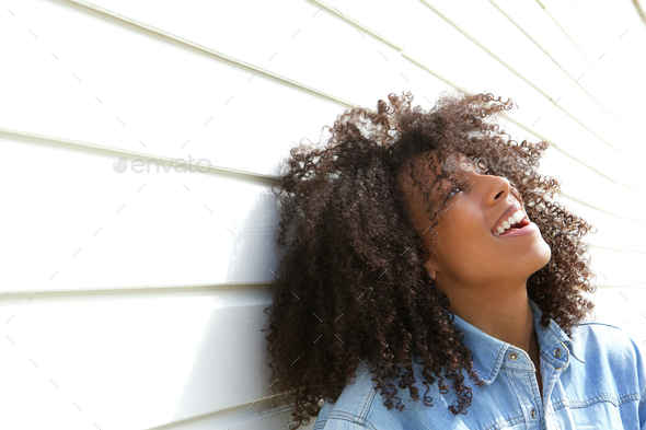 Beautiful young woman laughing outdoors - Stock Photo - Images