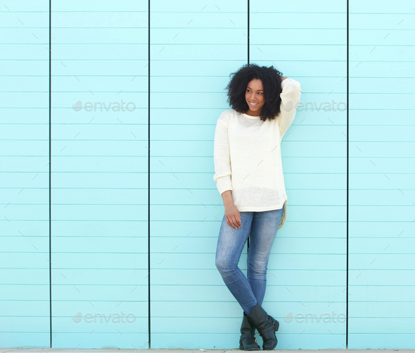 Attractive young female smiling outdoors - Stock Photo - Images