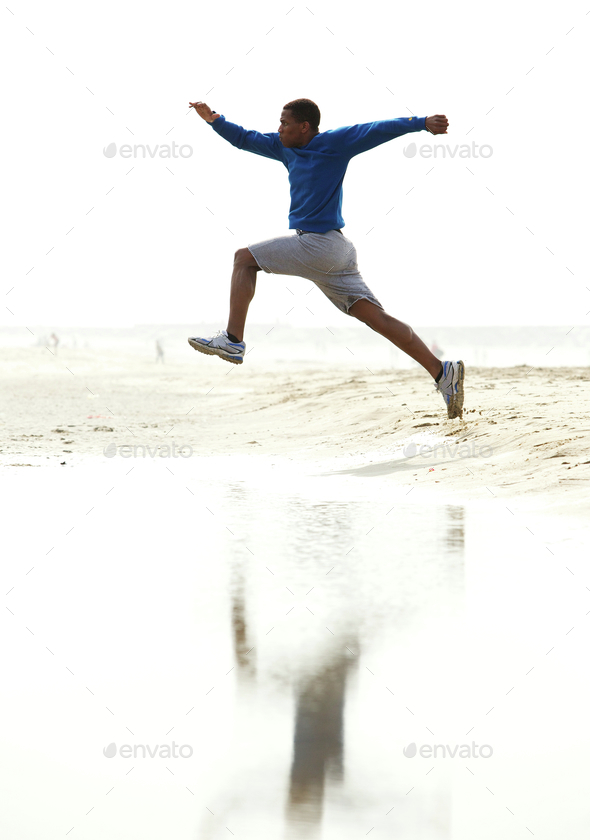 Young athletic male running - Stock Photo - Images