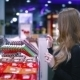 Girl Choosing Products on The Shelf in The Market - VideoHive Item for Sale