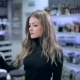 Girl Looks At Products From The Shelf In Store - VideoHive Item for Sale