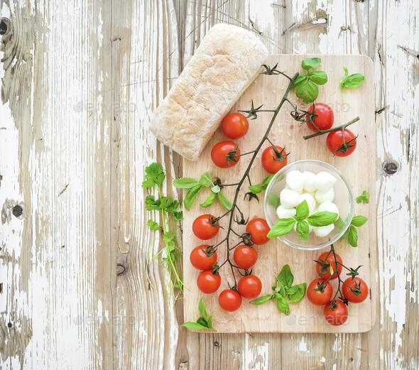 Ciabatta bread with banch of cherry-tomatoes, basil and mozzarella cheese - Stock Photo - Images