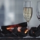 Sparkling Champagne Wine In Glasses In Front Of The Warm Fireplace.   - VideoHive Item for Sale