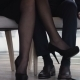 Young Couple Flirting With Legs At The Restaurant Under The Table - VideoHive Item for Sale