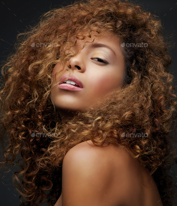 Beauty portrait of a female fashion model with curly hair - Stock Photo - Images