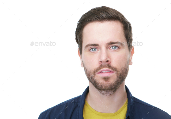 Handsome young man with beard looking at camera - Stock Photo - Images