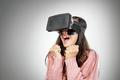 asian woman scared when wearing virtual reality goggle