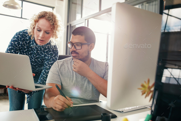 Two designers working in their office - Stock Photo - Images