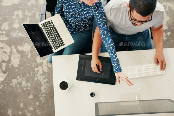 Young graphic designers coworking in office - Stock Photo - Images