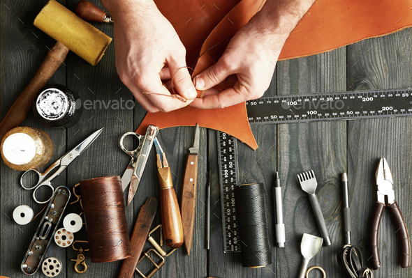 Man working with leather - Stock Photo - Images