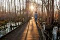 Teen walking at dawn