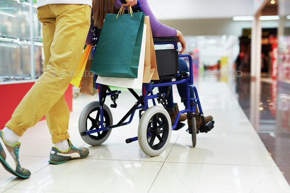 Shopping with disable girlfriend - Stock Photo - Images