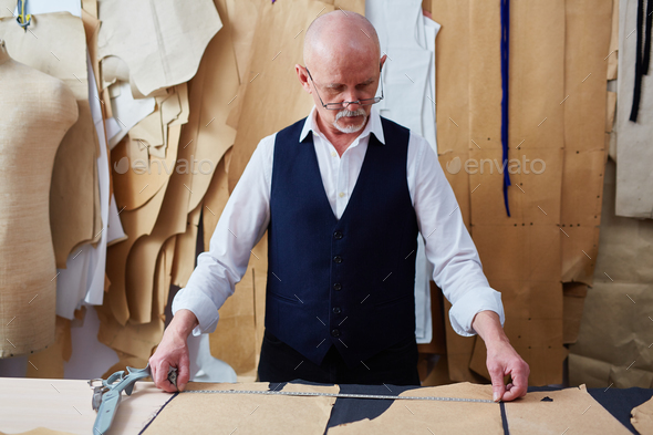 Mature tailor at work - Stock Photo - Images