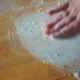Woman Hand Throwing Flour On The Table - VideoHive Item for Sale
