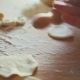 Making Of Dumplings. A Woman Is Rolling Dough With A Rolling Pin On A Table  - VideoHive Item for Sale