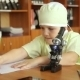 A Little Boy With a Microscope In a Research Lab - VideoHive Item for Sale