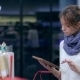 Girl Chooses Products With a Tablet In Supermarket - VideoHive Item for Sale