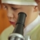 The Boy Looks Into The Microscope - VideoHive Item for Sale