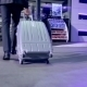 Businessman Goes With Suitcase To a Roadside Cafe - VideoHive Item for Sale