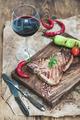 Cooked meat t-bone steak on serving board