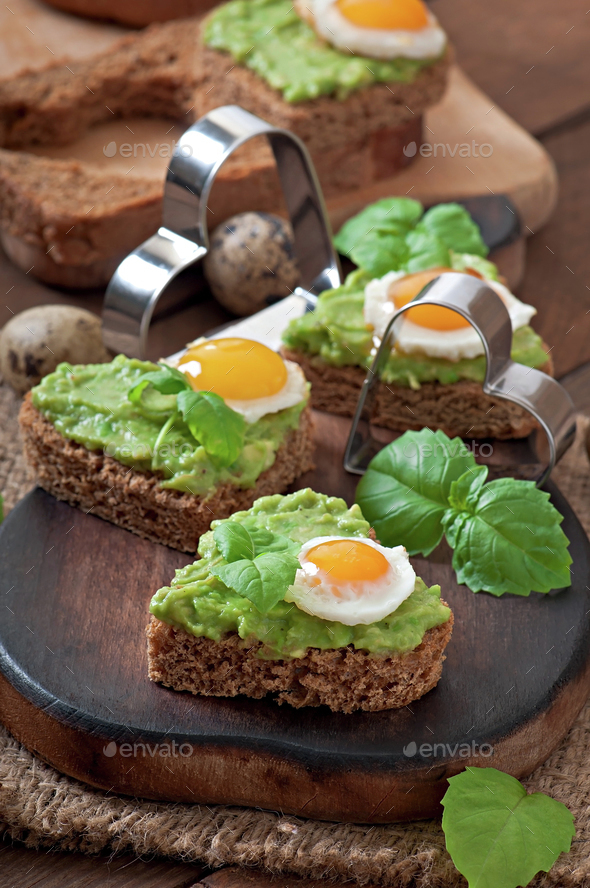 Sandwich with avocado paste and egg in the shape of heart - Stock Photo - Images