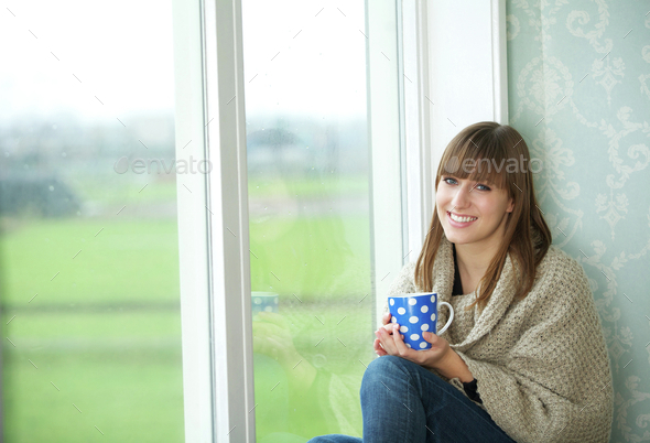 Young Woman Smiling with Tea Cup - Stock Photo - Images