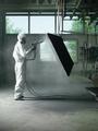 worker sand blasting a metal crate - PhotoDune Item for Sale
