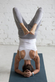 Yoga Indoors: variation of Supported Headstand - PhotoDune Item for Sale