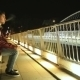Young Man Smoking Cigarette On a Bridge At The Night - VideoHive Item for Sale