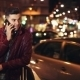Young Man Calling On Mobile Phone At Night In City. - VideoHive Item for Sale