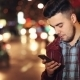 Man Sms Texting Using App On Smart Phone At Night In City - VideoHive Item for Sale