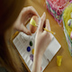Woman Paints a Festive Easter Egg Yellow - VideoHive Item for Sale