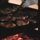 Cook Prepares Steaks On The Grill  - VideoHive Item for Sale