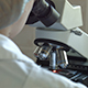 Researcher Viewing Through Microscope - VideoHive Item for Sale