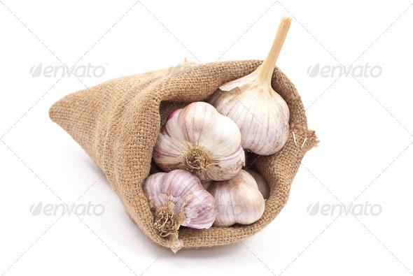 Burlap sack with garlic - Stock Photo - Images