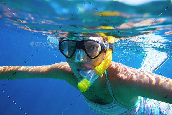 Young women is snorkeling in the tropical water - Stock Photo - Images