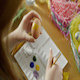 A Woman Paints an Easter Egg Yellow  - VideoHive Item for Sale