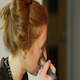 Woman Using a Makeup Brush on her Face - VideoHive Item for Sale