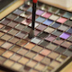 Woman Dabs a Small Brush into a Makeup Palette - VideoHive Item for Sale